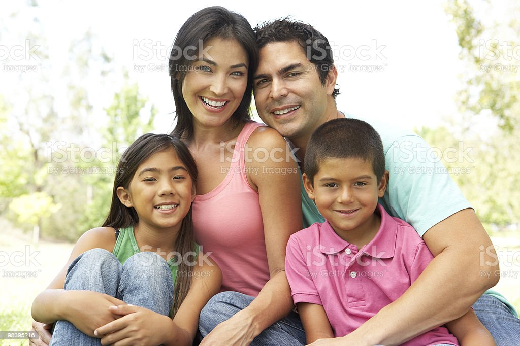 Portrait Of Young Family In Park royalty-free stock photo