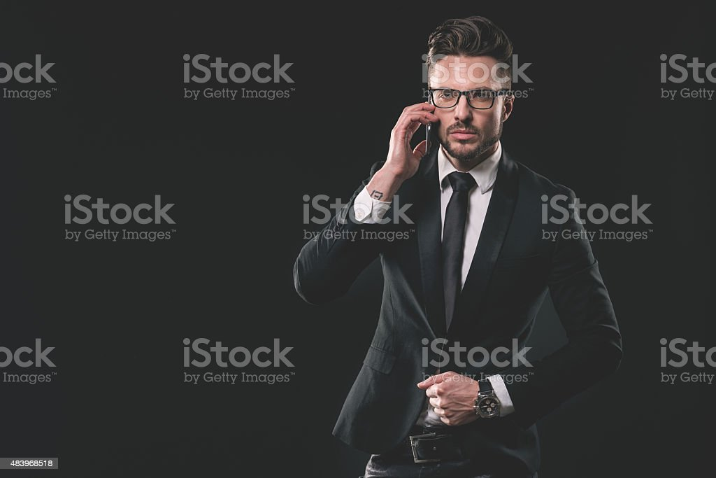 Portrait of young fashionable man with mobile phone stock photo