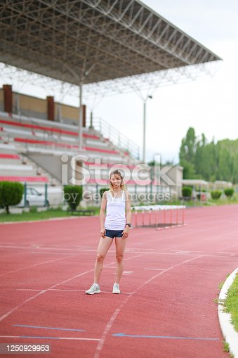 portrait of young female athlete in the stadium