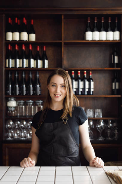 Portrait Of Young Female Bar Owner stock photo