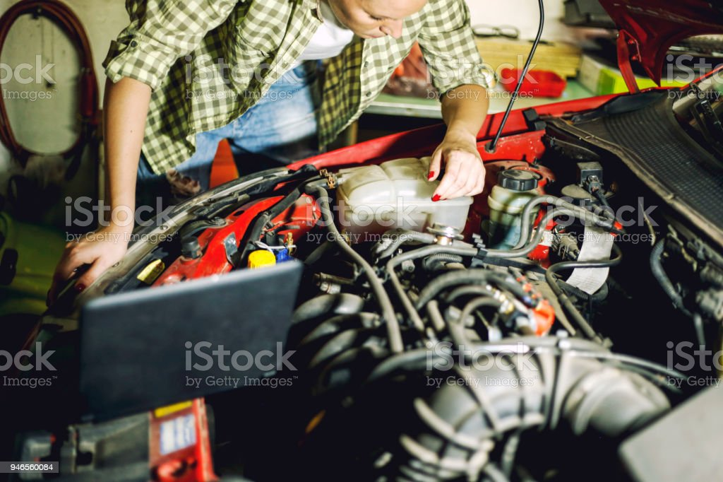 portrait of young female mechanic repair car in auto repair shop picture id946560084 portrait of young female mechanic repair car in auto repair shop
