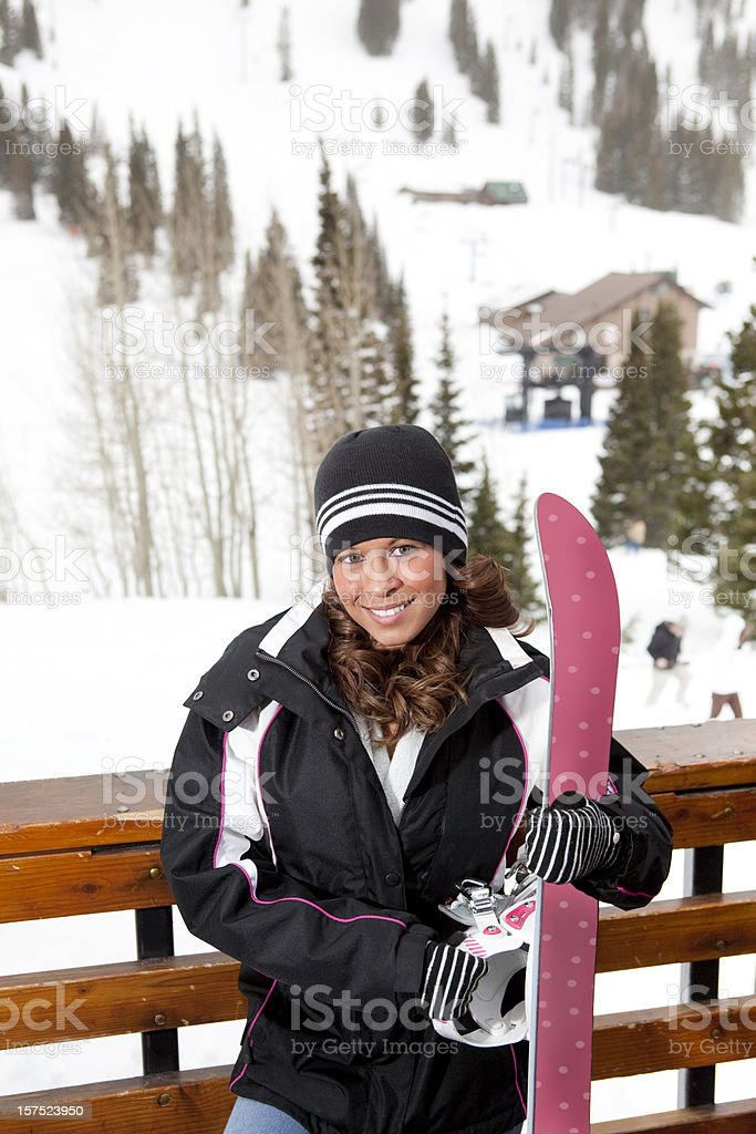 Portrait of young female snowboarder royalty-free stock photo