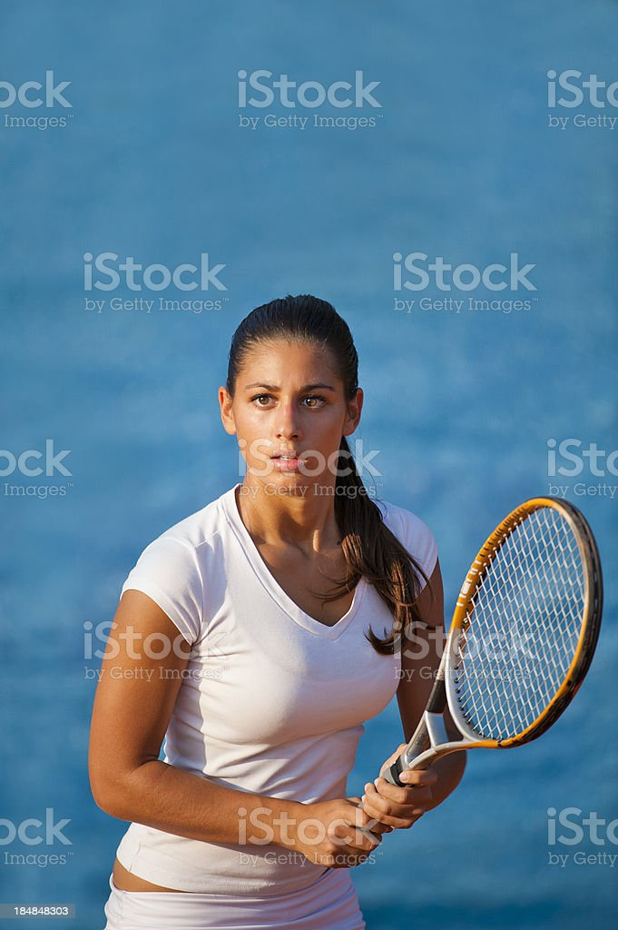 Portrait of young female tennis player concentrating royalty-free stock photo