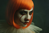 istock Portrait of young female with clown make-up. Halloween celebration. 1282331370