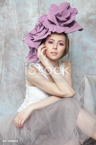 portait of young woman in gentle colorrs and flower