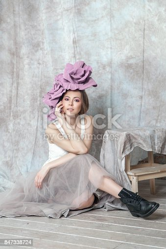 spring concept cute girl with flower in head and tender colors