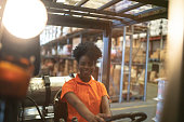 Portrait of young forklift driver woman