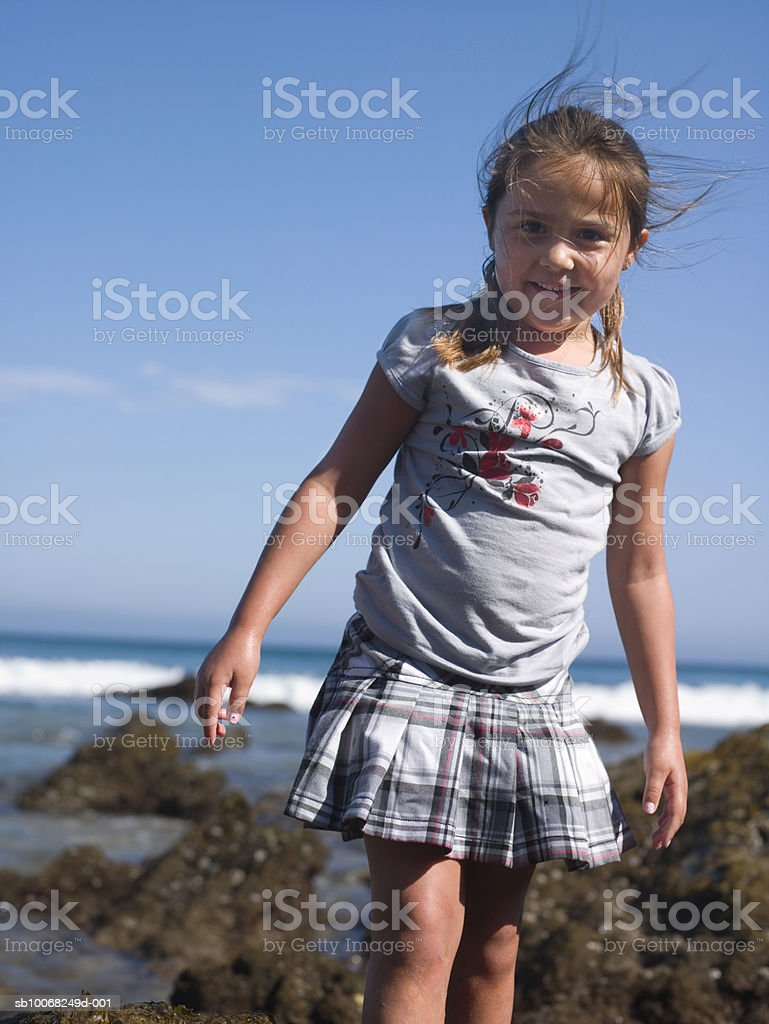 Portrait of young girl (6-7) at seashore royalty-free stock photo