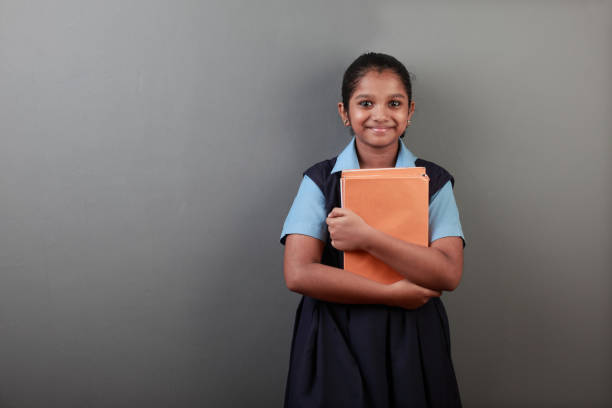 Portrait of young girl holding note books in her hands stock photo