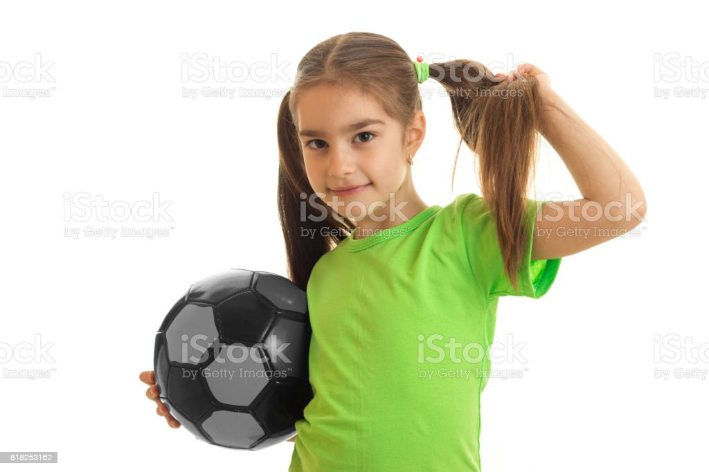 0340442fa portrait of young girl in green shirt with soccer ball in hands royalty-free  stock