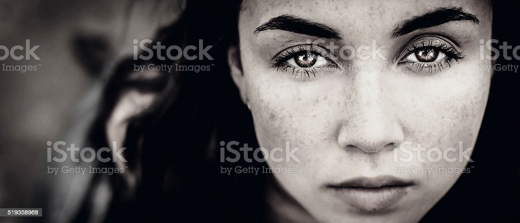 Portrait of young girl outdoor looking up stock photo