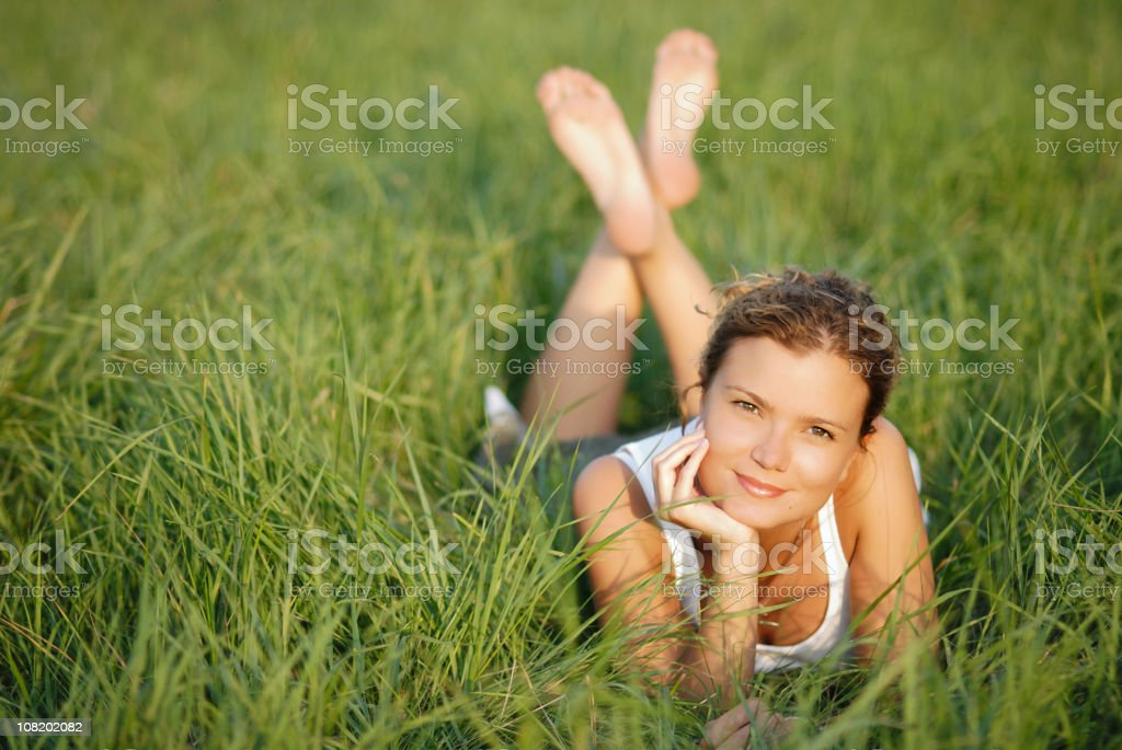 Portrait of Young Girl Relaxing in Green Grass royalty-free stock photo