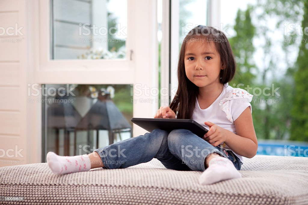 Portrait of Young Girl with Digital Tablet royalty-free stock photo