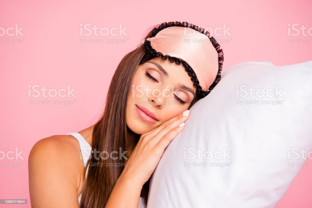 Portrait of young gorgeous smiling lady wearing eye mask sleeping on...