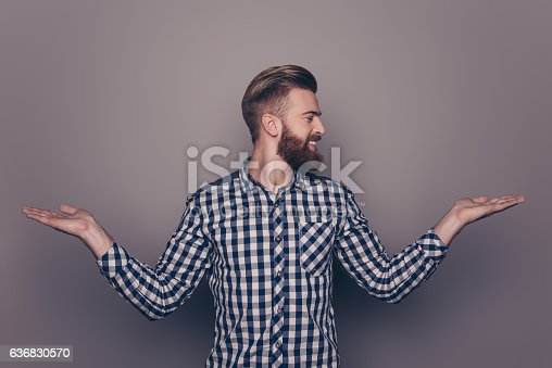 636829300 istock photo Portrait of young guy choosing between two different options 636830570
