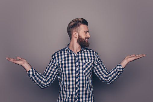636829368 istock photo Portrait of young guy choosing between two different options 636830570