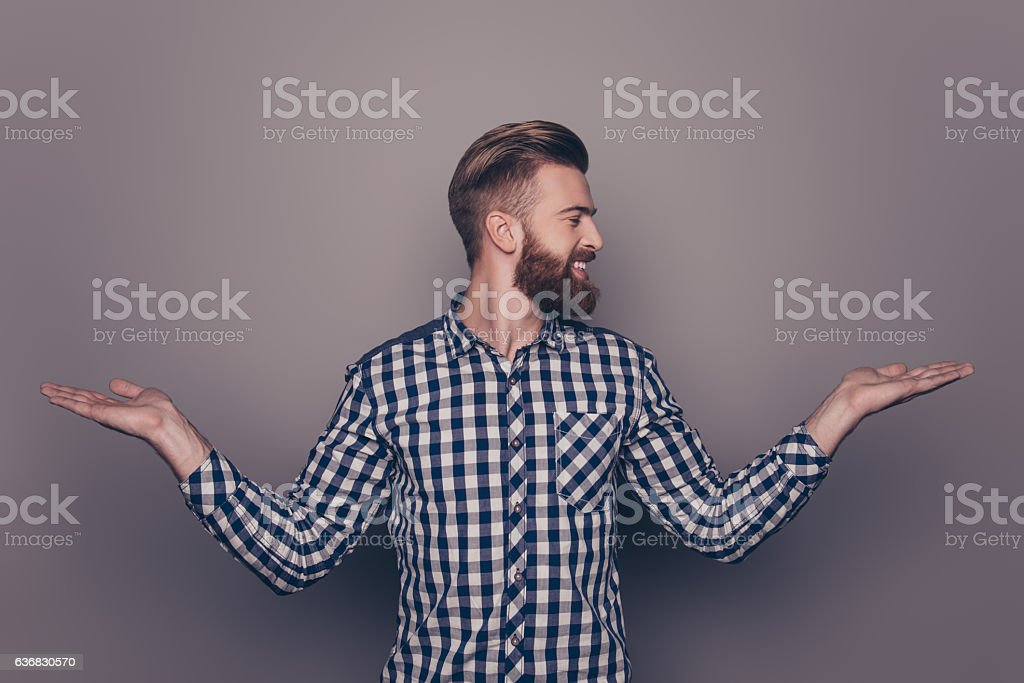 Portrait of young guy choosing between two different options stock photo