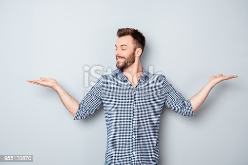 istock Portrait of young guy choosing between two different options 955120870