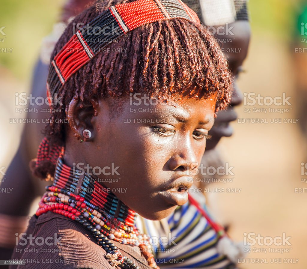 Portrait of young Hamar woman at bull jumping ceremony. stock photo