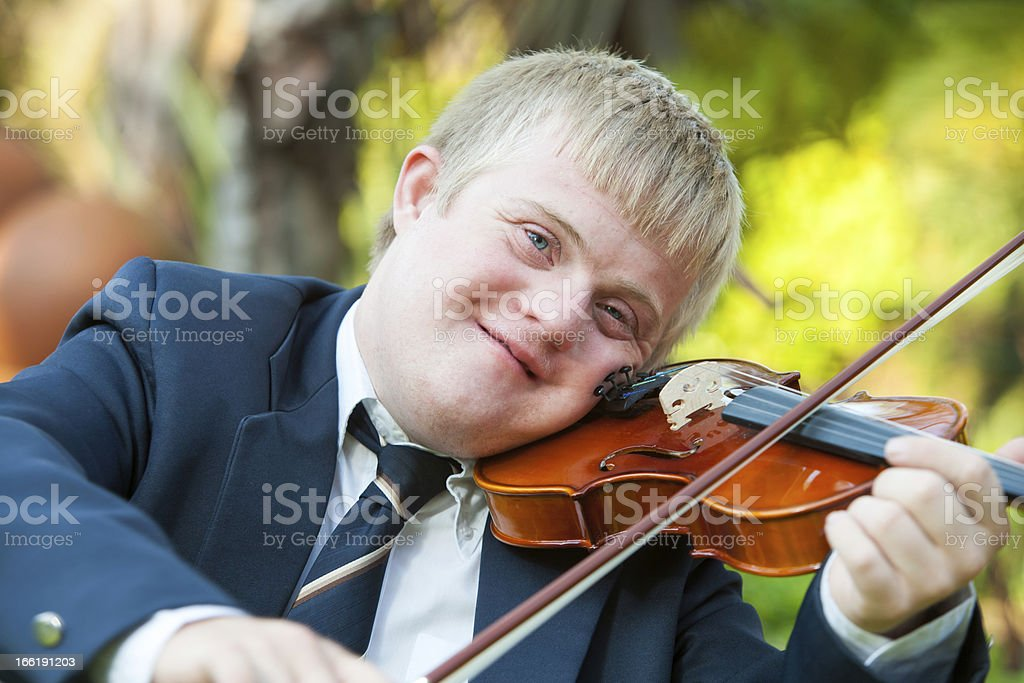 Portrait of young handicapped violinist. royalty-free stock photo