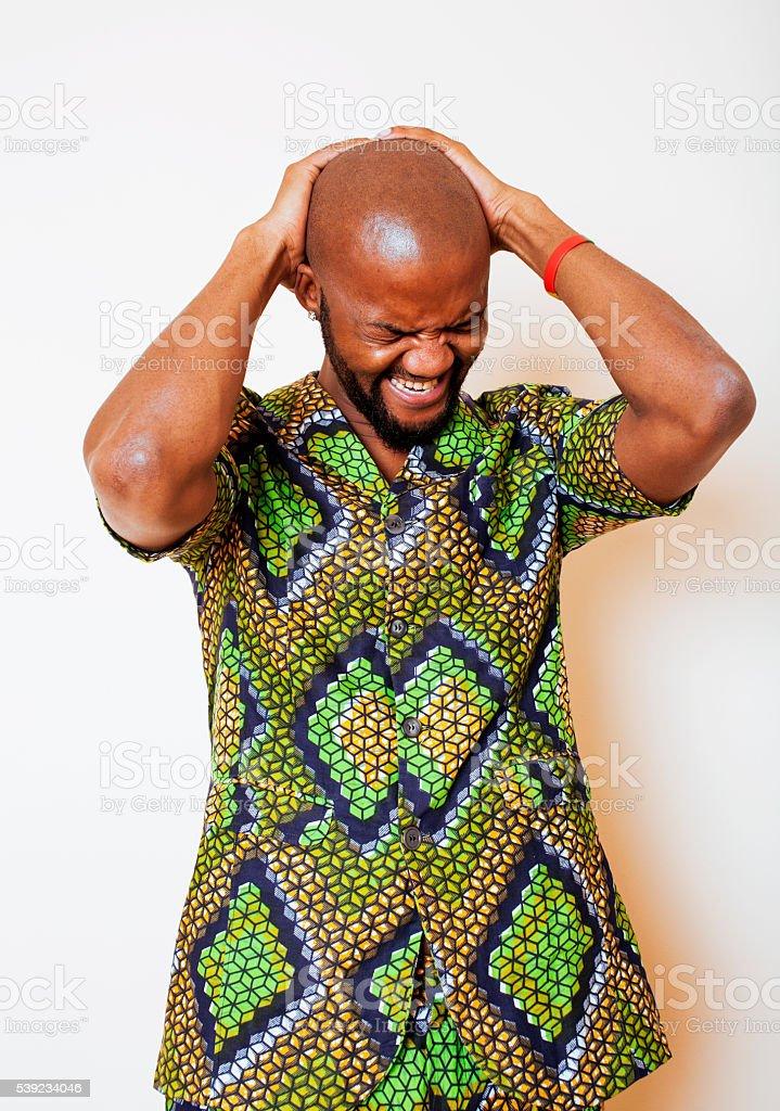 Retrato de joven atractivo hombre africano verde brillante nacional USA foto de stock libre de derechos