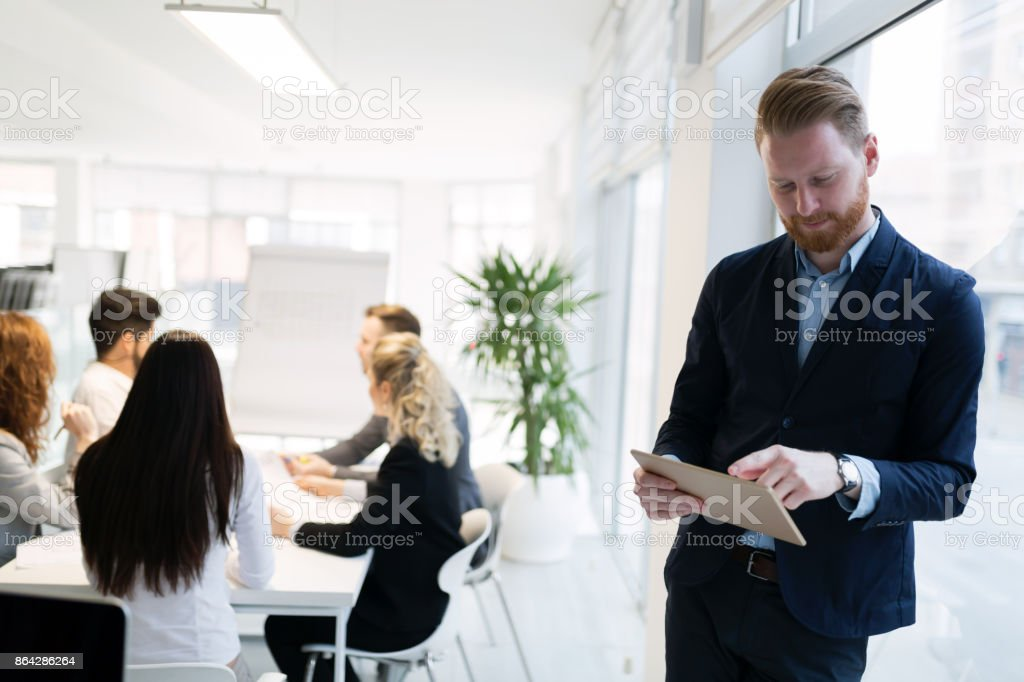 Portrait of young handsome architect on meeting royalty-free stock photo