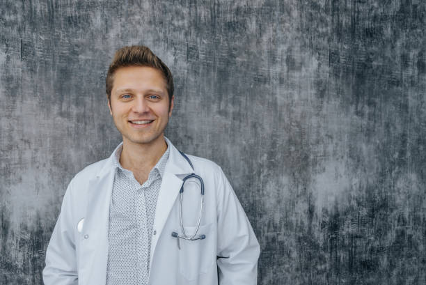 Portrait of young handsome healthcare professional at hospital stock photo