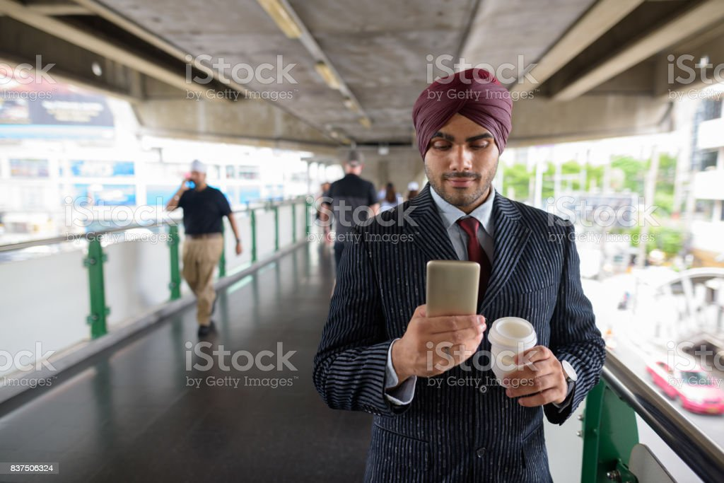 Portrait Of Young Handsome Indian Sikh Businessman Wearing