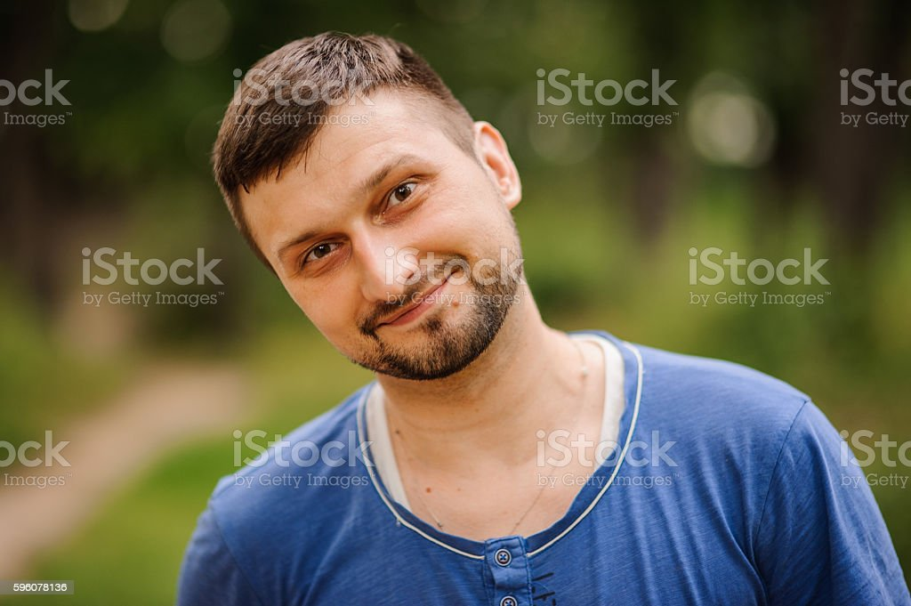 portrait of young handsome man posing outdoors. royalty-free stock photo