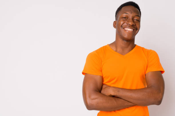 Portrait of young happy African man smiling with arms crossed stock photo