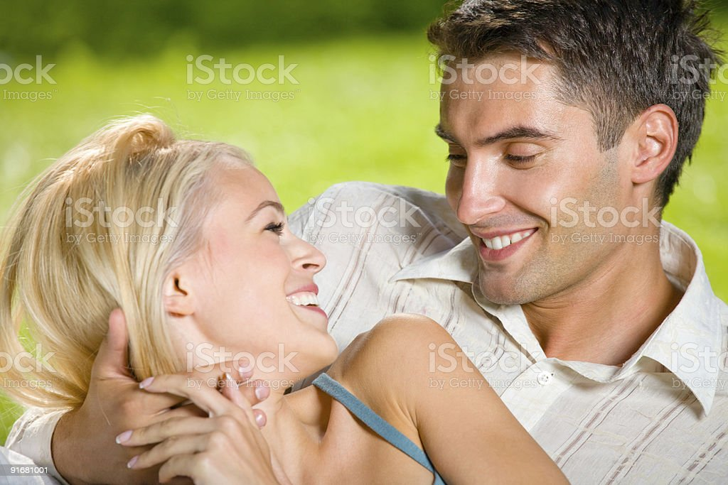 Portrait of young happy attractive couple together, outdoors royalty-free stock photo