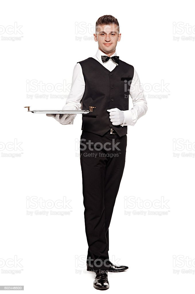Portrait of young happy smiling waiter with on tray isolated stock photo