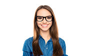 Portrait of young happy teacher in glasses with beaming smile