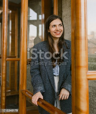135359671 istock photo Portrait of young happy woman smiling 1215345179