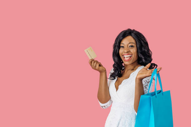 Portrait of young happy woman with shopping bag and credit card looking at camera excited Portrait of young happy woman with shopping bag and credit card looking at camera excited excited stock pictures, royalty-free photos & images