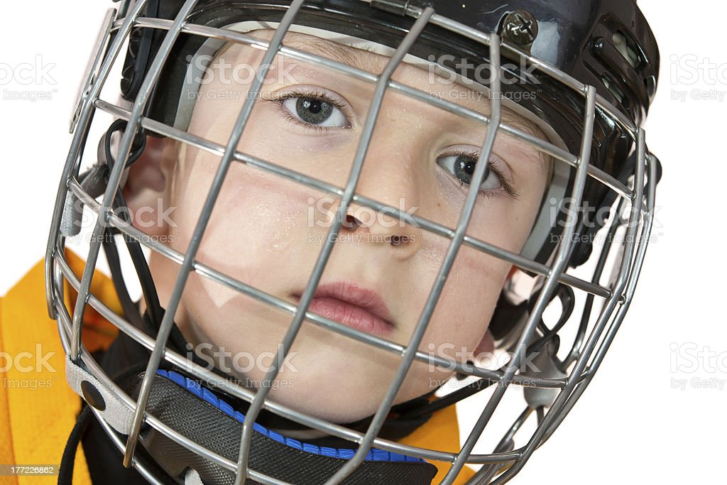 Portrait of young hockey player in sweat drops on face royalty-free stock photo