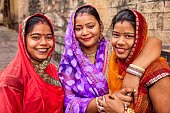 Portrait of young Indian women, Jodhpur. Jodhpur is known as the Blue City due to the vivid blue-painted houses around the Mehrangarh Fort.
