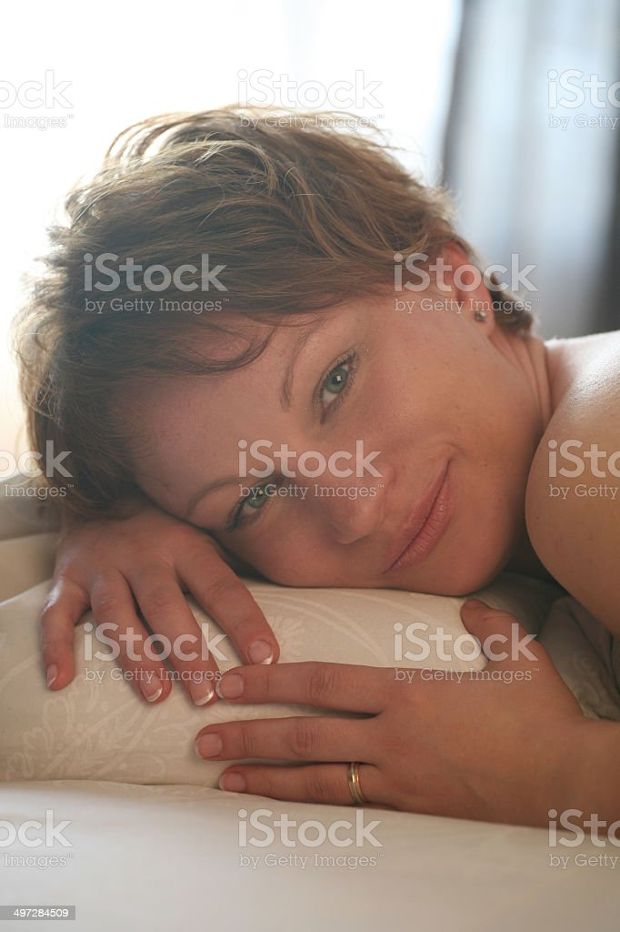 Portrait of young lady sleeping on pillow and happy smiling royalty-free stock photo