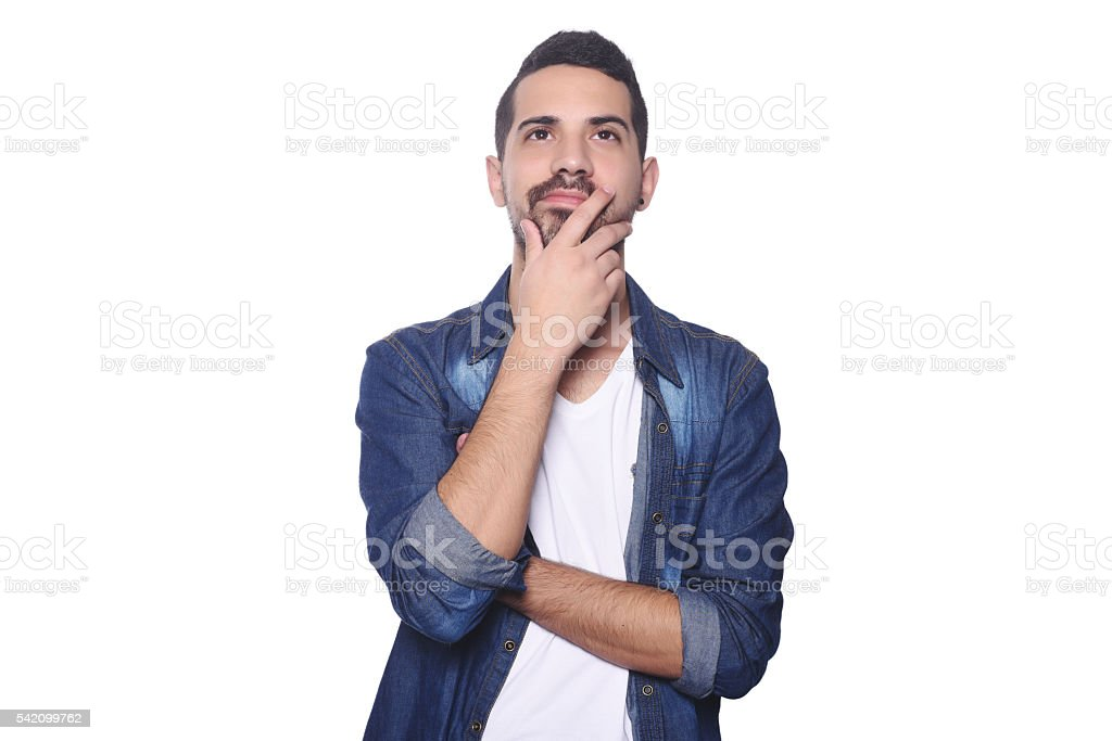 Portrait of young latin thoughtful man. stock photo