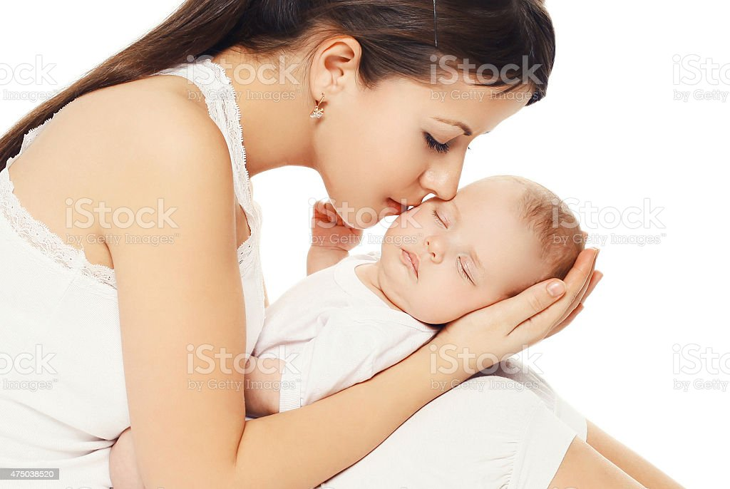 Portrait of young loving mother kissing her baby Portrait of young loving mother kissing her baby 2015 Stock Photo