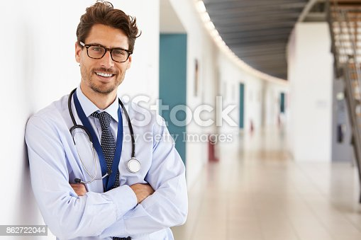 istock Portrait of young male doctor with stethoscope, close up 862722044