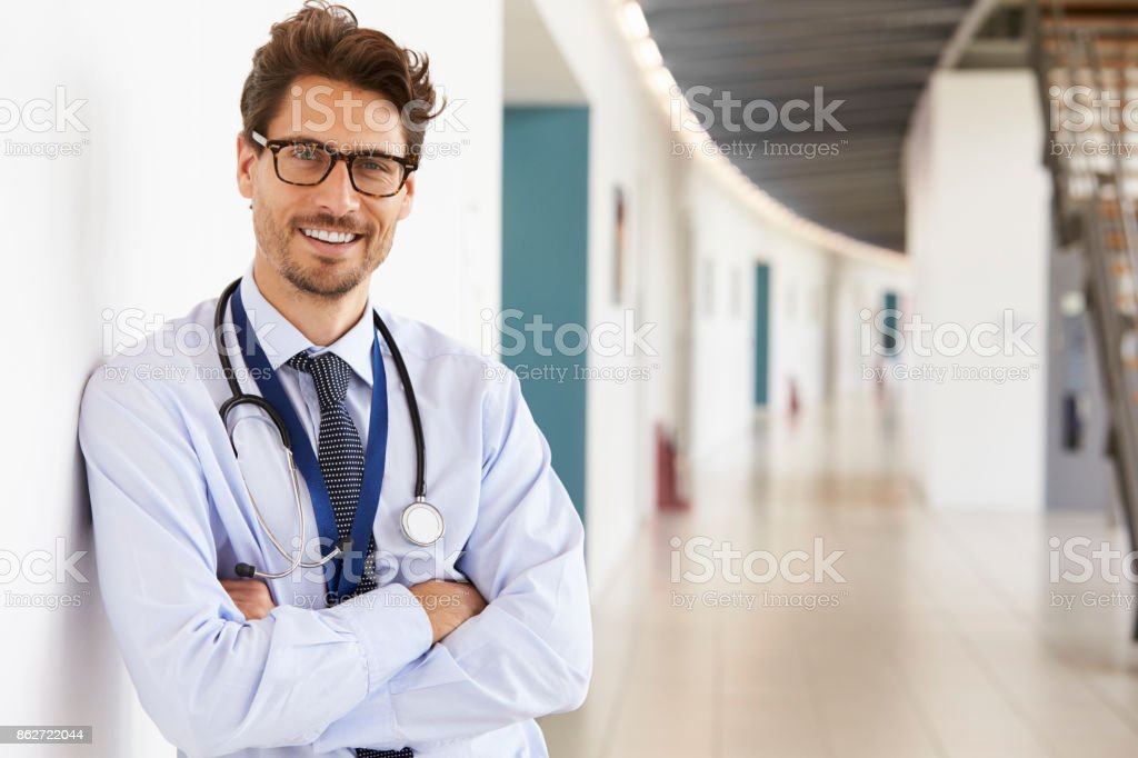 Portrait of young male doctor with stethoscope, close up stock photo