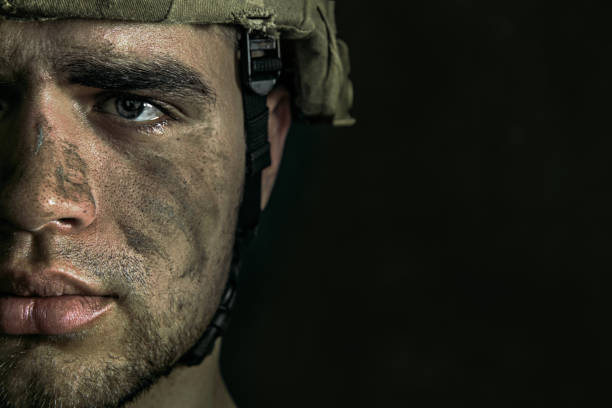 Portrait of young male soldier Confusing what is real. Close up portrait of young male soldier. Man in military uniform on the war. Depressed and having problems with mental health and emotions, PTSD, rehabilitation. post traumatic stress disorder stock pictures, royalty-free photos & images