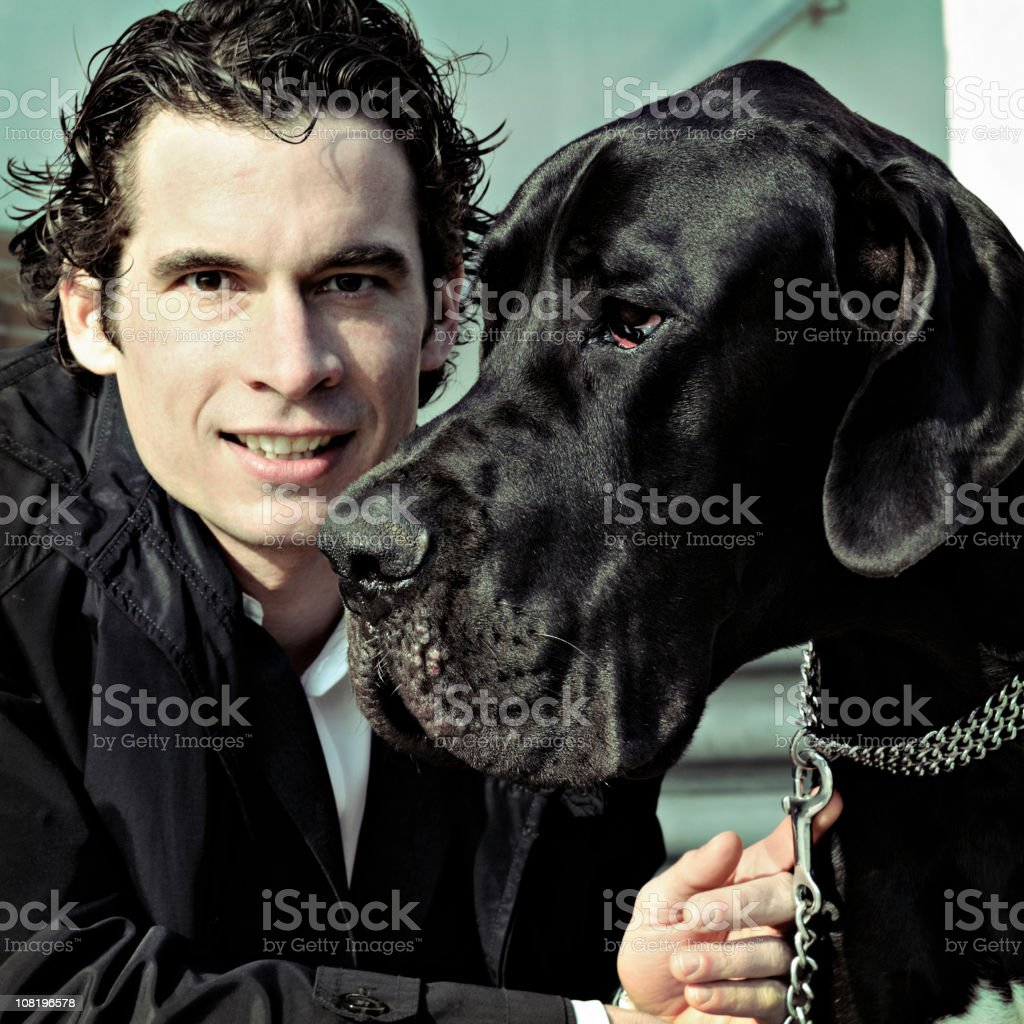 Portrait of Young Man and Mastiff Dog royalty-free stock photo