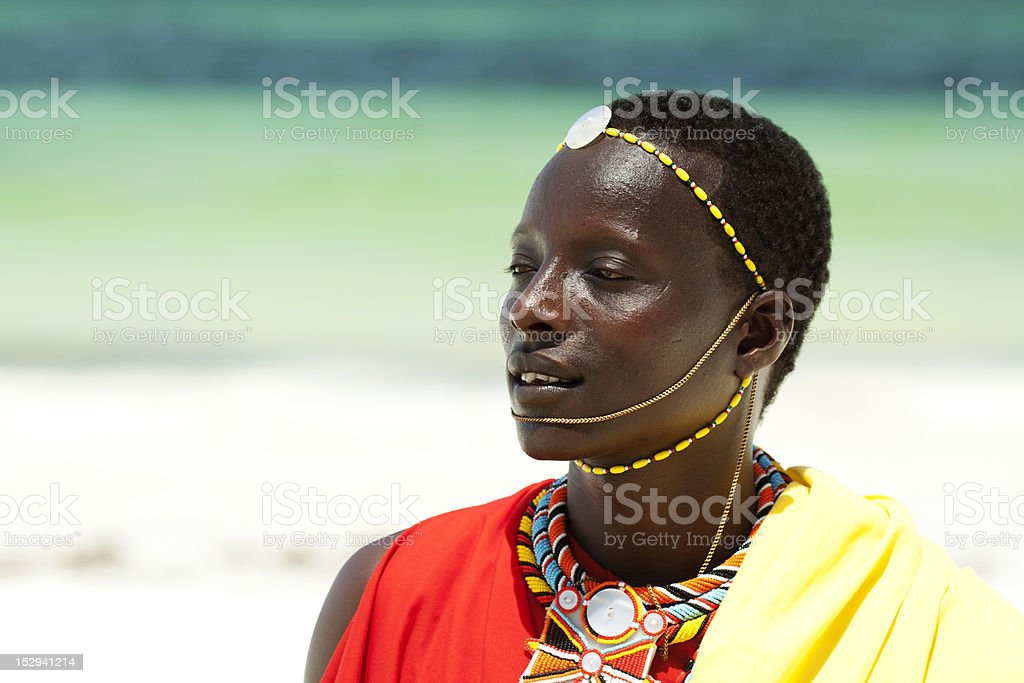 Portrait of young man as Massai warior stock photo