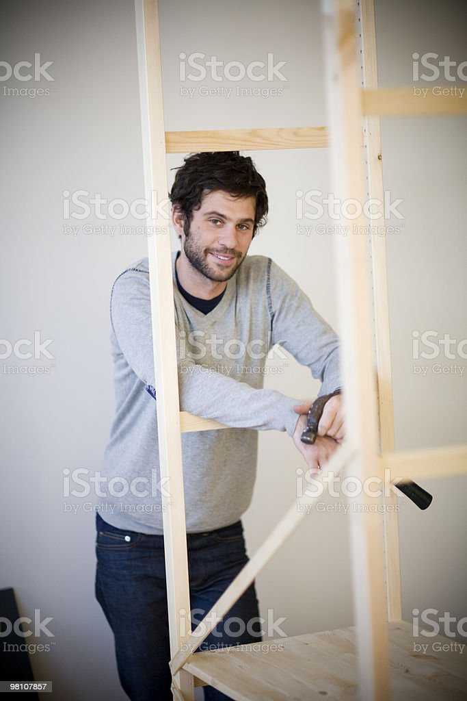 Portrait of young man doing home repair. royalty-free stock photo