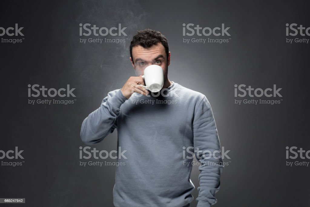 Portrait of young man drinking coffee foto de stock royalty-free