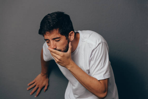Portrait of young man drunk or sick vomiting stock photo