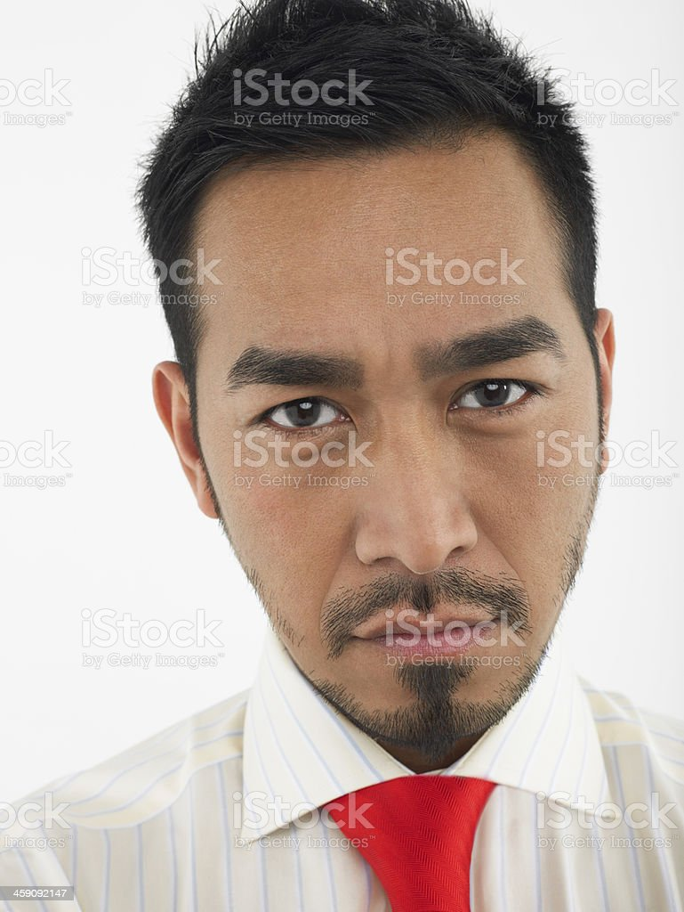 Portrait Of Young Man Frowning stock photo