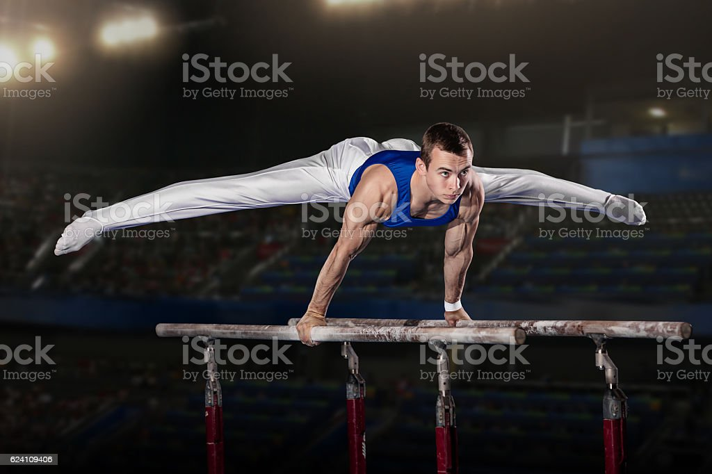 portrait of young man gymnasts - Photo